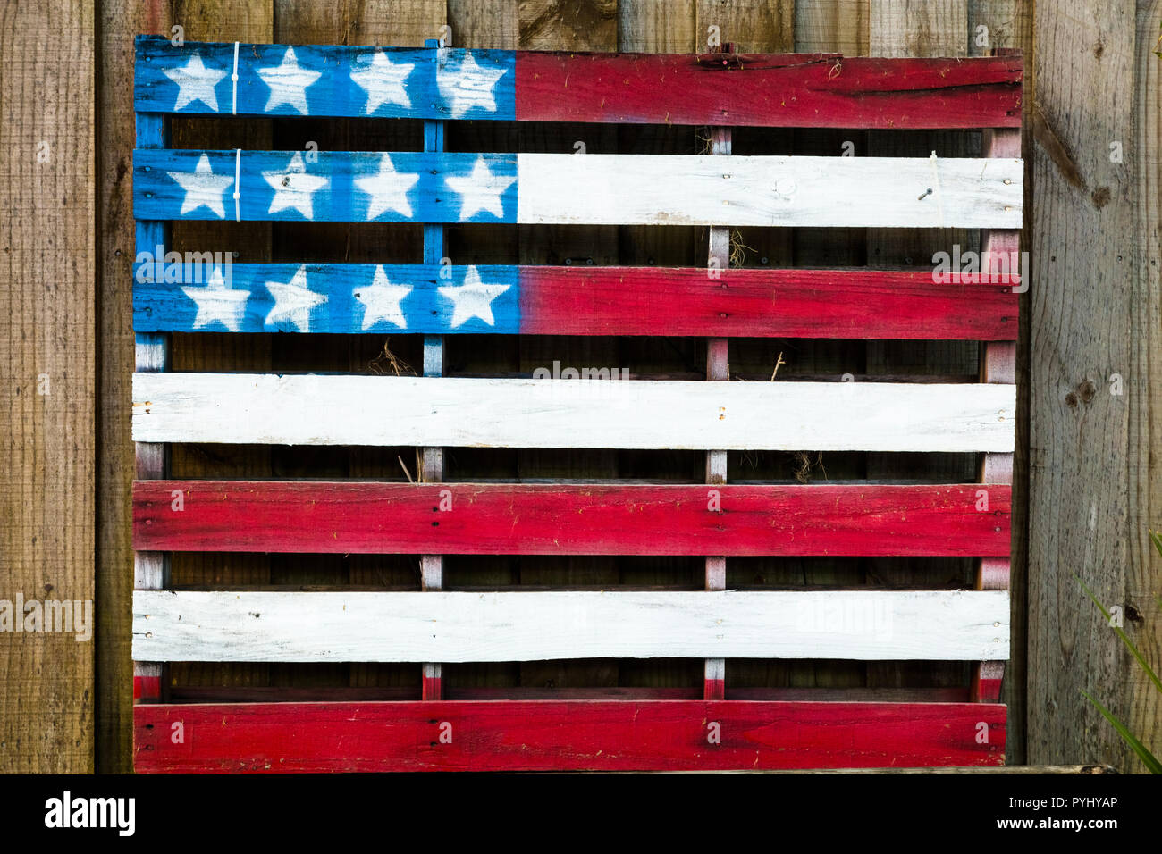 American flag painted on wood shipping pallet - Stock Image