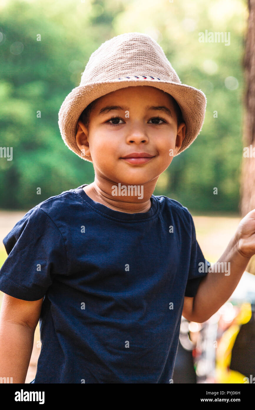 766501af432 Close up portrait of little boy smiling with hat outdoors Stock ...