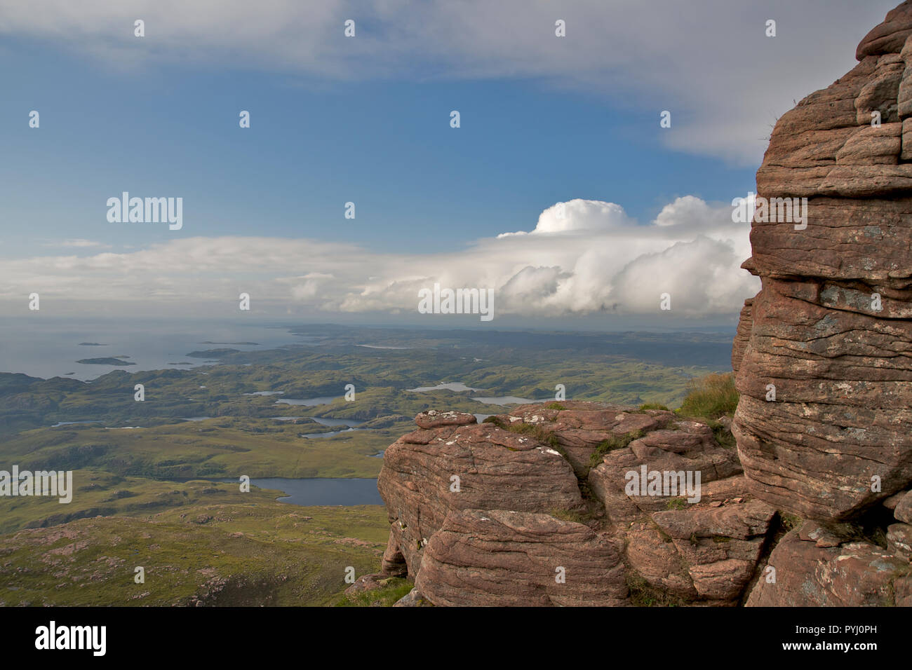 High view over Assynt, Scotland from ridge on Stac Pollaidh mountain Stock Photo