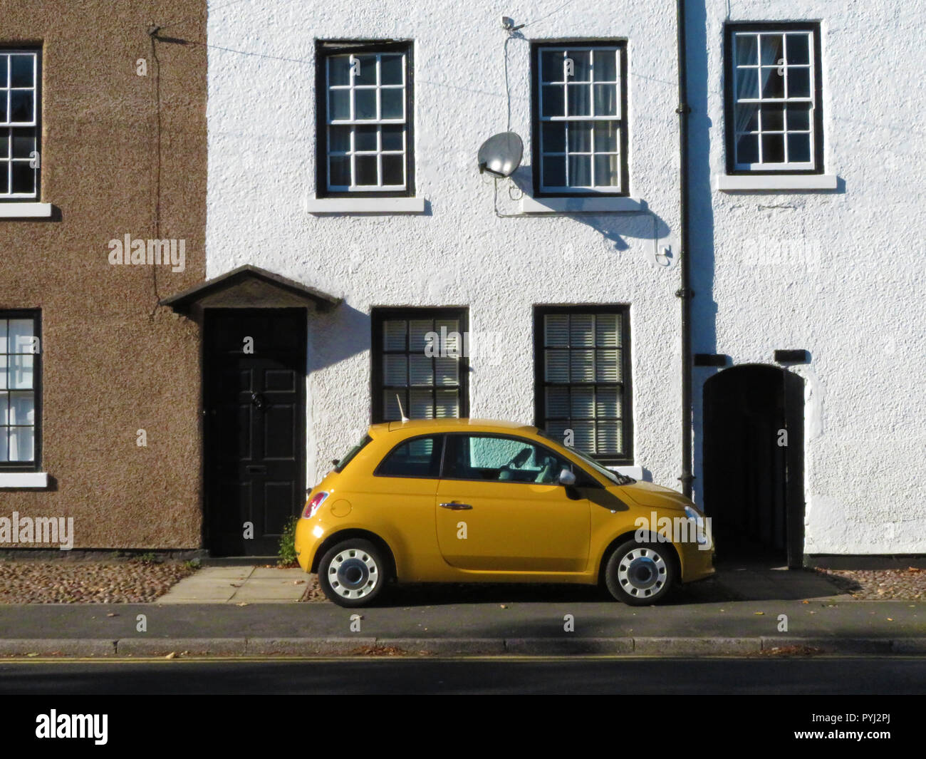 Small Yellow Fiat Car Parked Outside A Terraced House In Bawtry