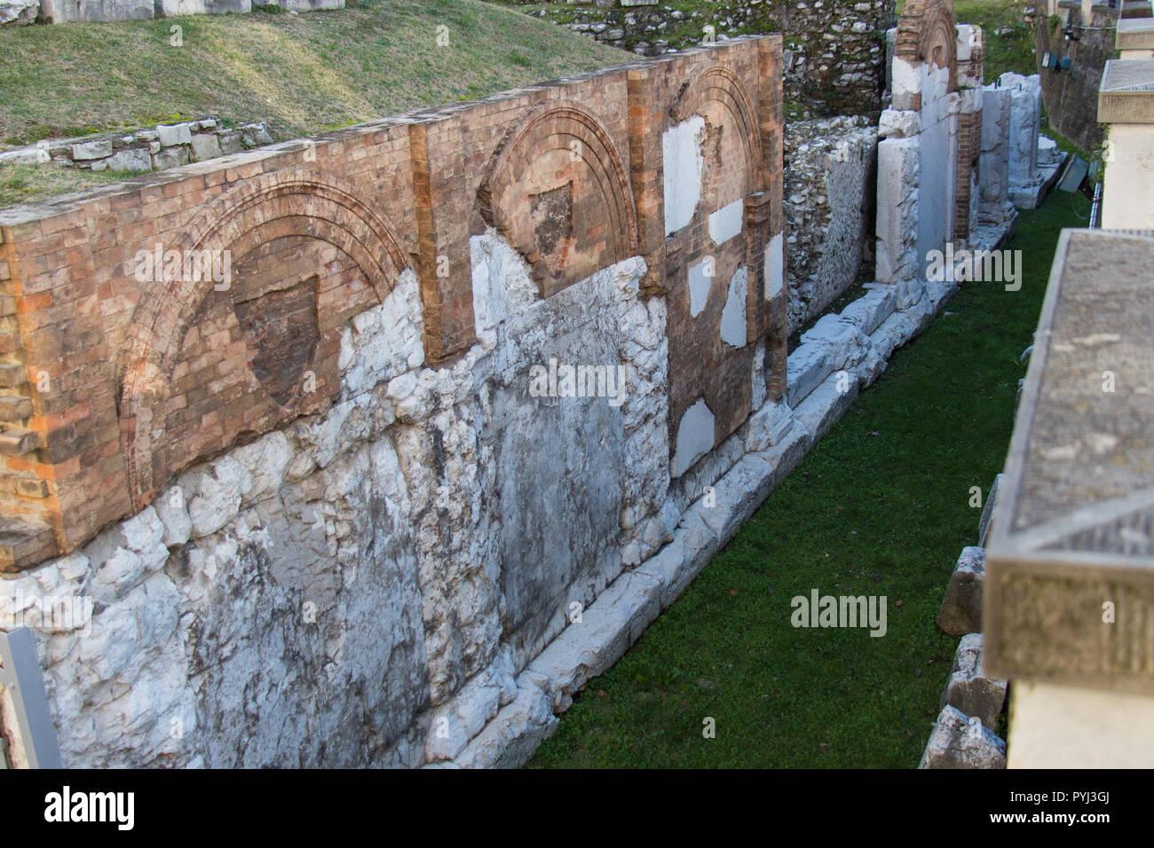 Italy, Brescia - December 24 2017: the view ruins of Foro Romano of Capitolium, Ancient Roman temple, UNESCO World Heritage Site on December 24 2017. - Stock Image