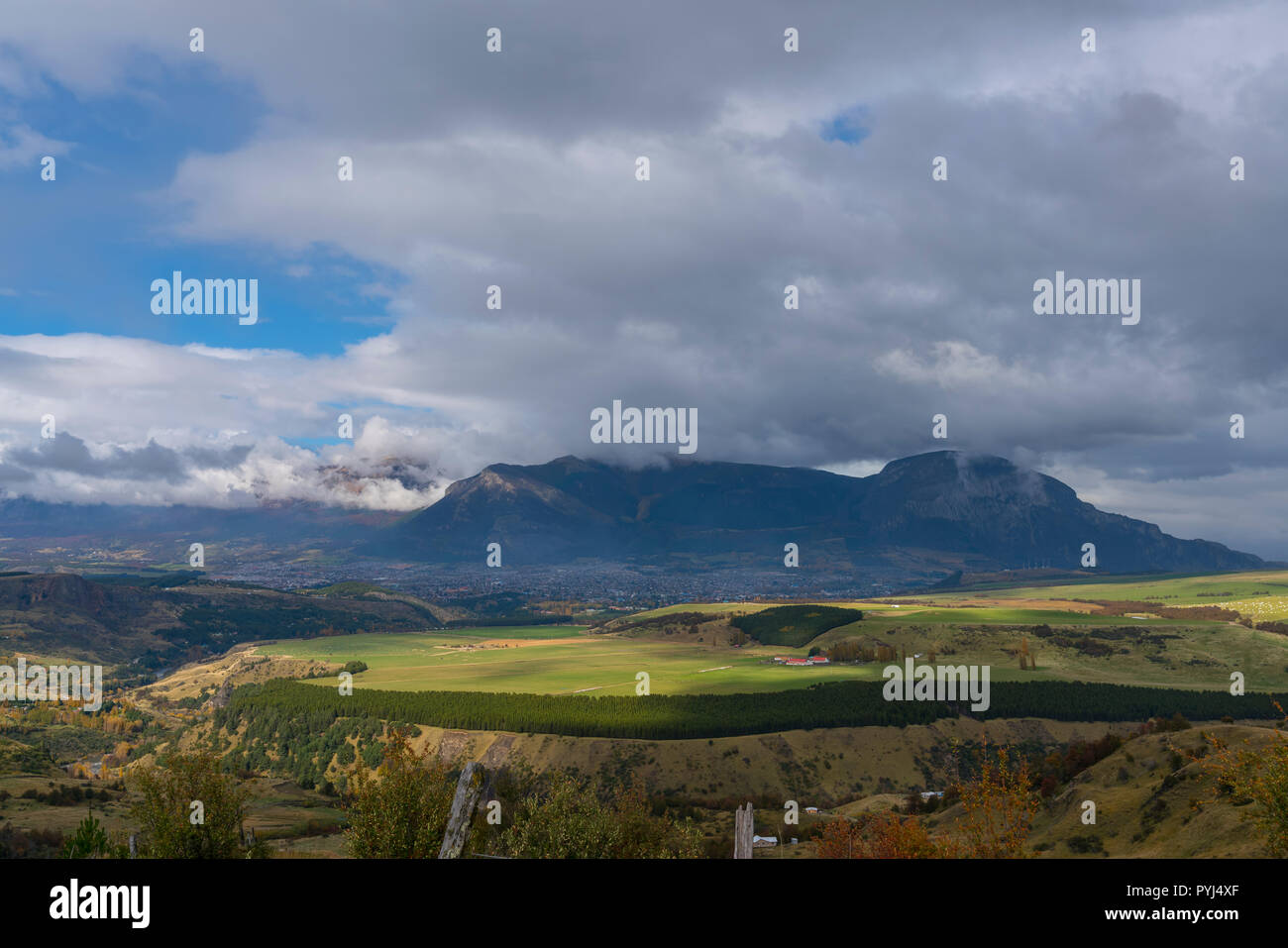 Landscape of the city of Coyhaique seen from a viewpoint on the outskirts of the city, it is observed the rain clouds on it, southern Chile - Stock Image