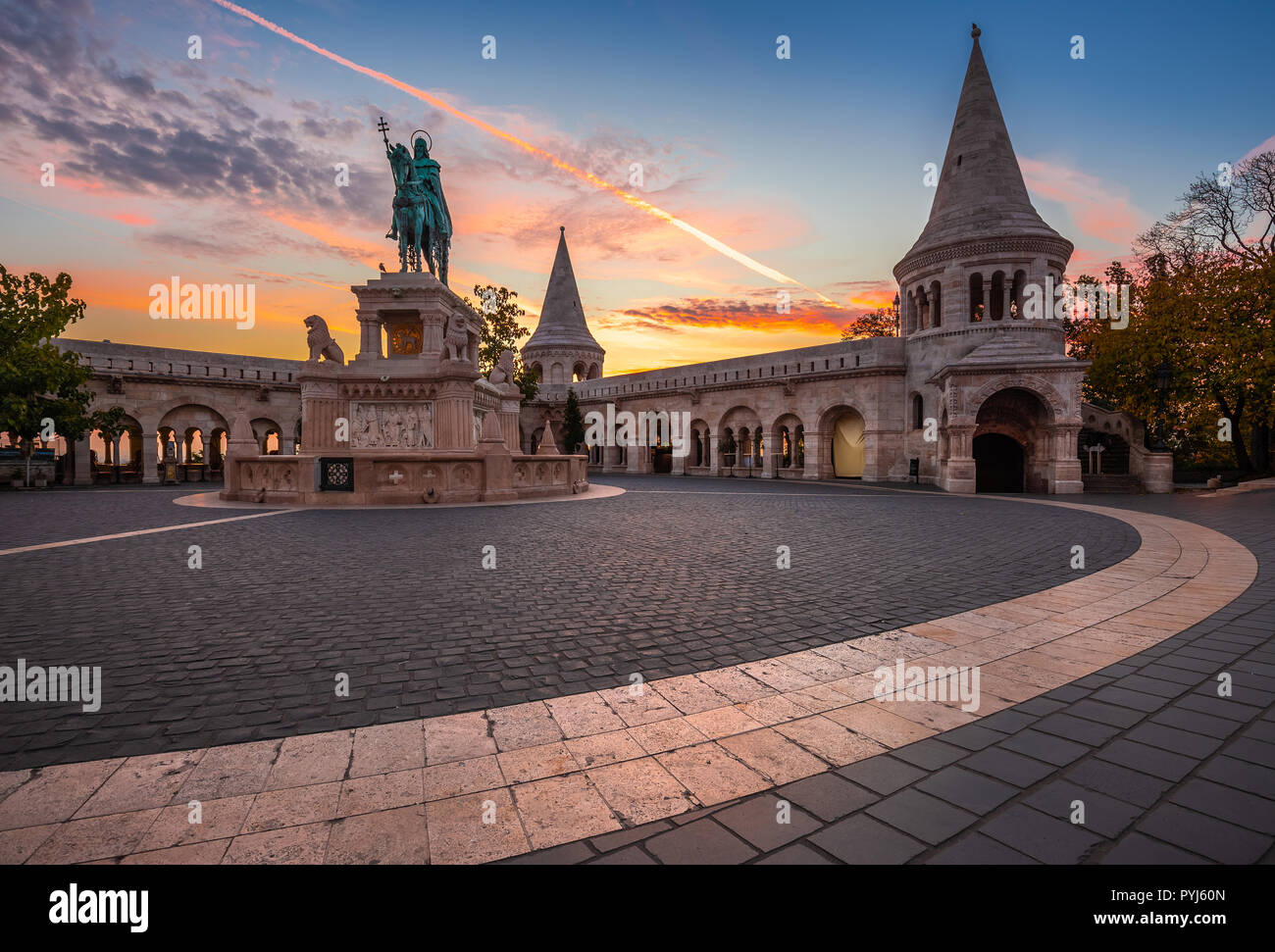Budapest, Hungary - Autumn sunrise at the Fisherman's Bastion with King Stephen I statue and beautiful sky and clouds - Stock Image