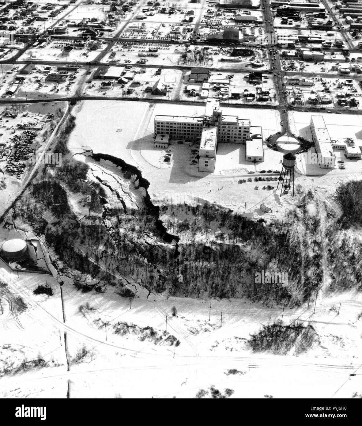 March 27, 1964 Alaska earthquake. The landslide occurred next to this hospital in Anchorage which is showing graben and pressure ridges. Stock Photo