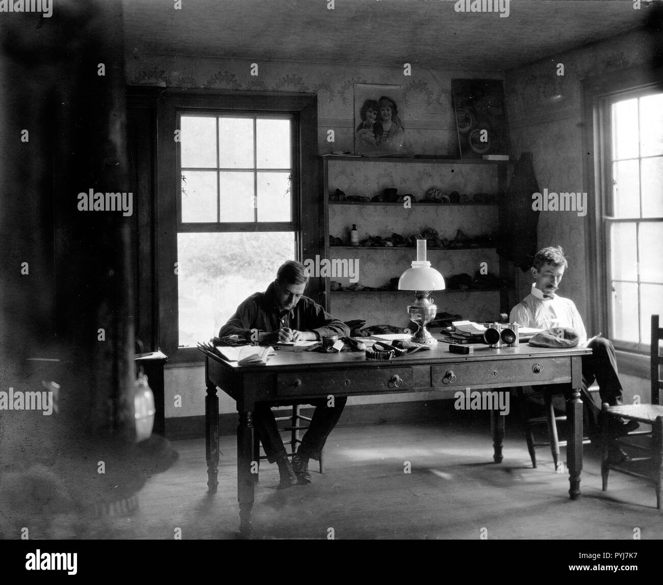 These gentleman geologists are hard at work in their field office going over their field notes. This photo was taken in 1903 in Crab Orchard, Lee County, Virginia. - Stock Image