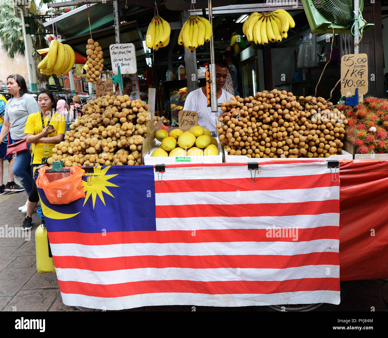 A Longan fruit vendor at the market in KL, Malaysia. - Stock Image
