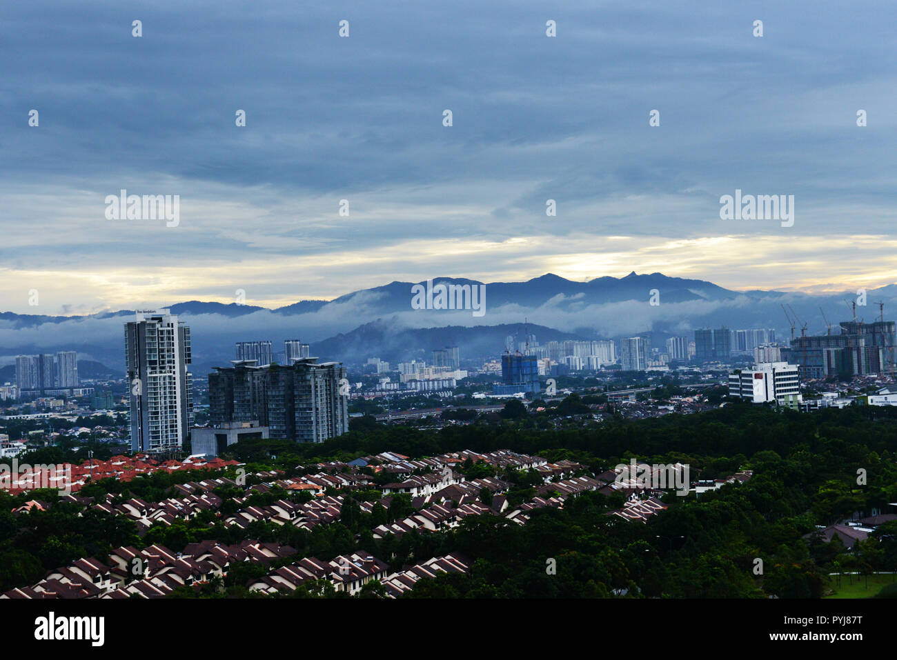 KL morning view with a fog along the mountains. - Stock Image