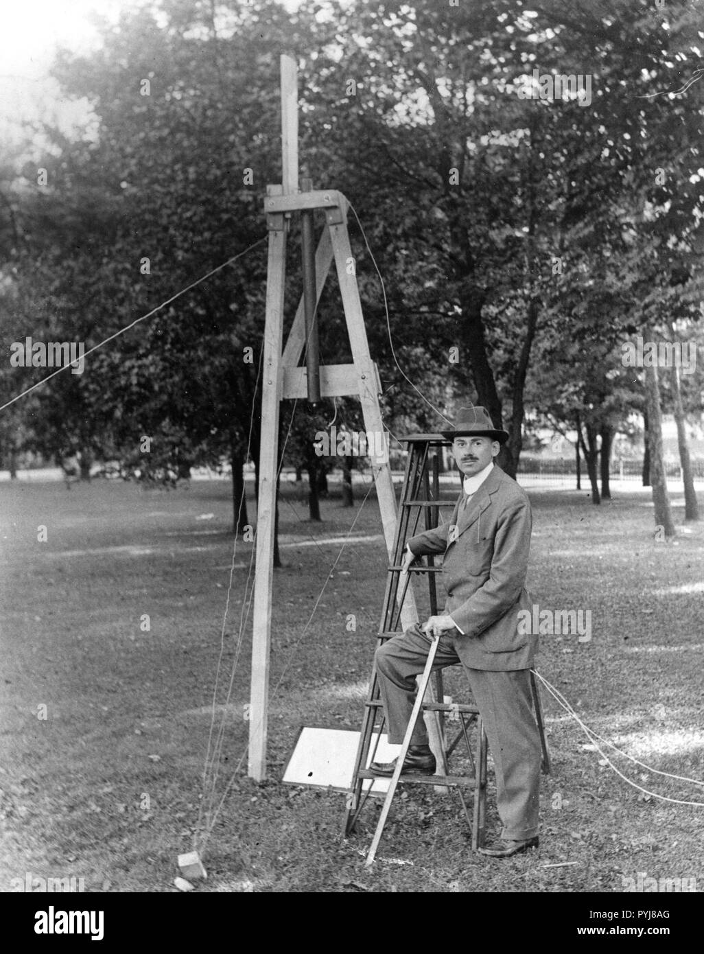 Dr. Robert Goddard on the campus of Clark University, Worcester, Mass. mounting a srocket chamber for the 1915-1916 experiments.  Dr. Goddard earned his doctorate at Clark and also taught physics there. - Stock Image