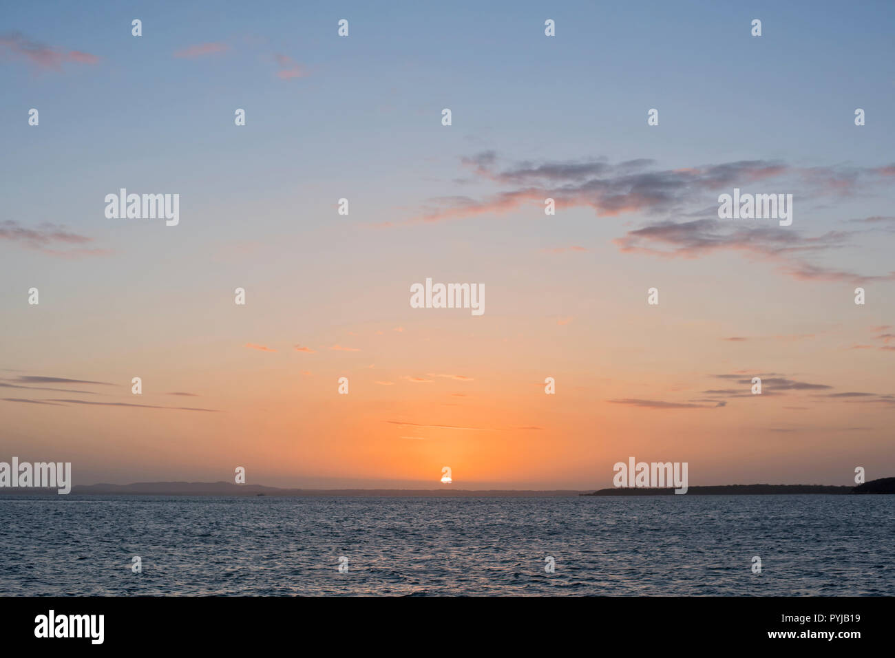 Beautiful Sunset night sky with very distant view of Brisbane as seen from Moreton Island, Queensland, Australia. - Stock Image