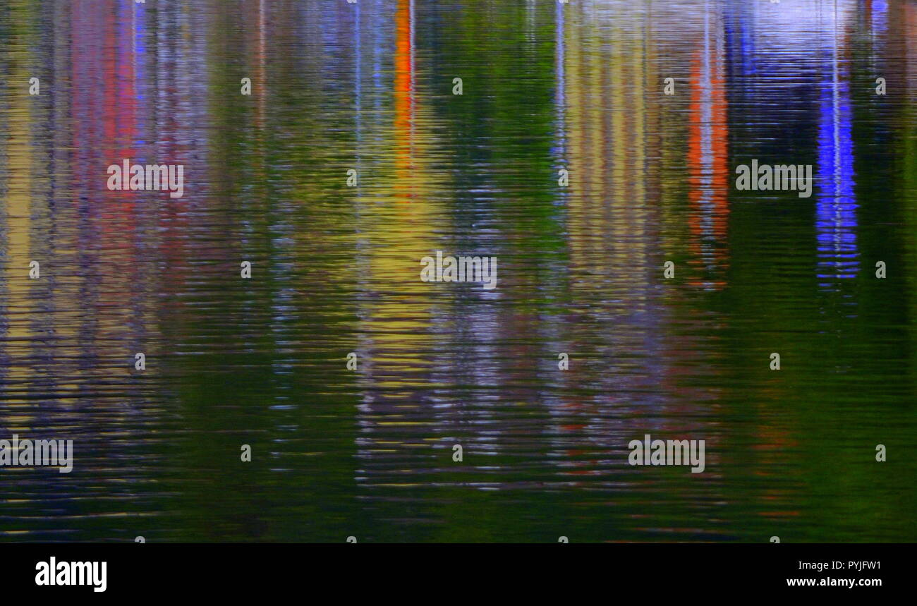 The reflected light of colored houses standing at the river - Stock Image