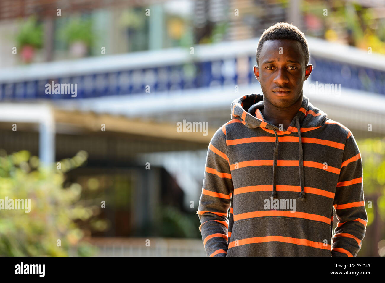6ef024c0 Portrait of young African man outdoors wearing hoodie Stock Photo ...