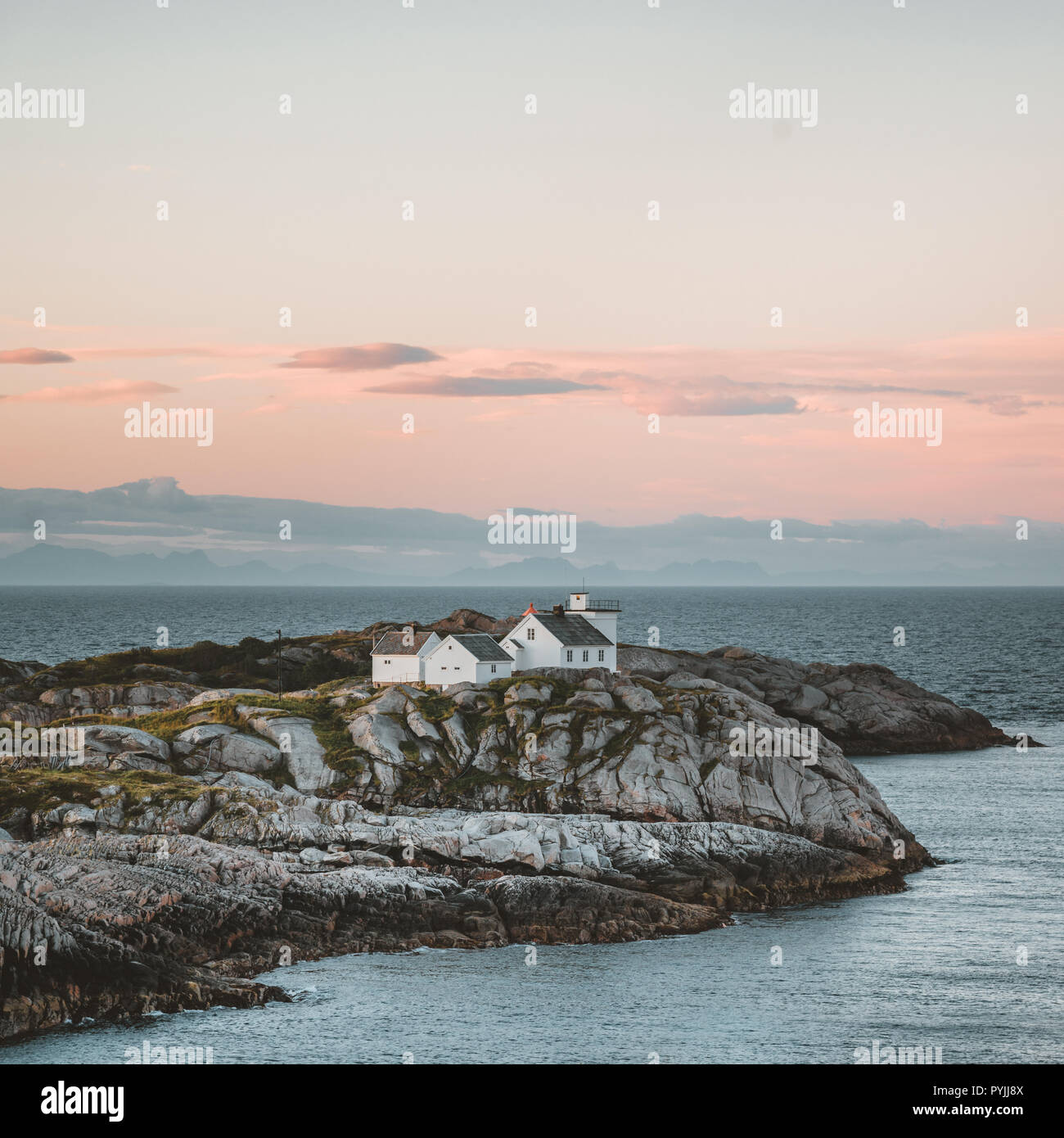 Sunrise and Sunset at Henningsvaer lighthouse with pink sky. The small fishing village located on several small islands in the Lofoten archipelago, No Stock Photo