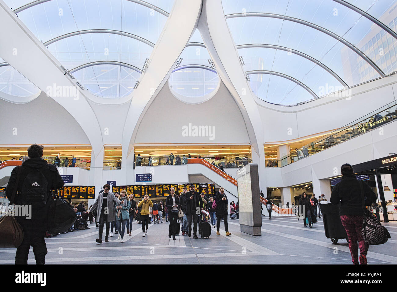 Birmingham New Street Station. Woman with travel suitcase. Men with   travel bags. People going out. - Stock Image