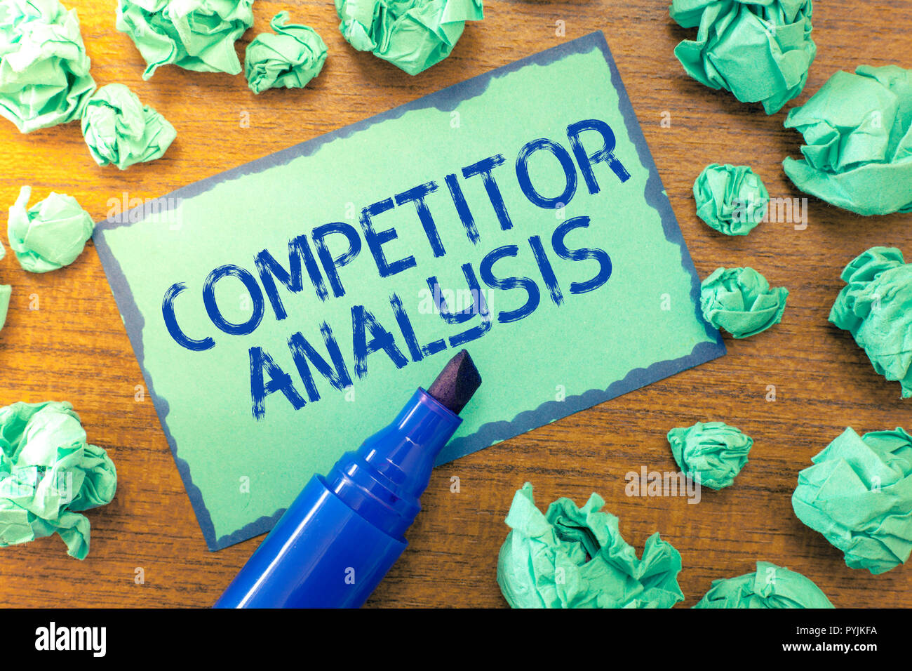 Handwriting text Competitor Analysis. Concept meaning Determine the Strength Weakness of Competitive Market. - Stock Image