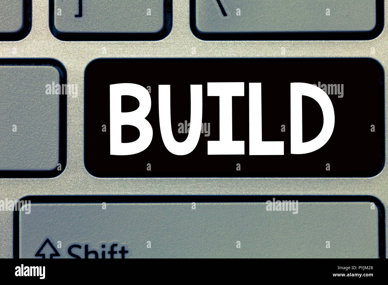 Conceptual hand writing showing Build. Business photo text Construct something by putting material together over a period of time. - Stock Image