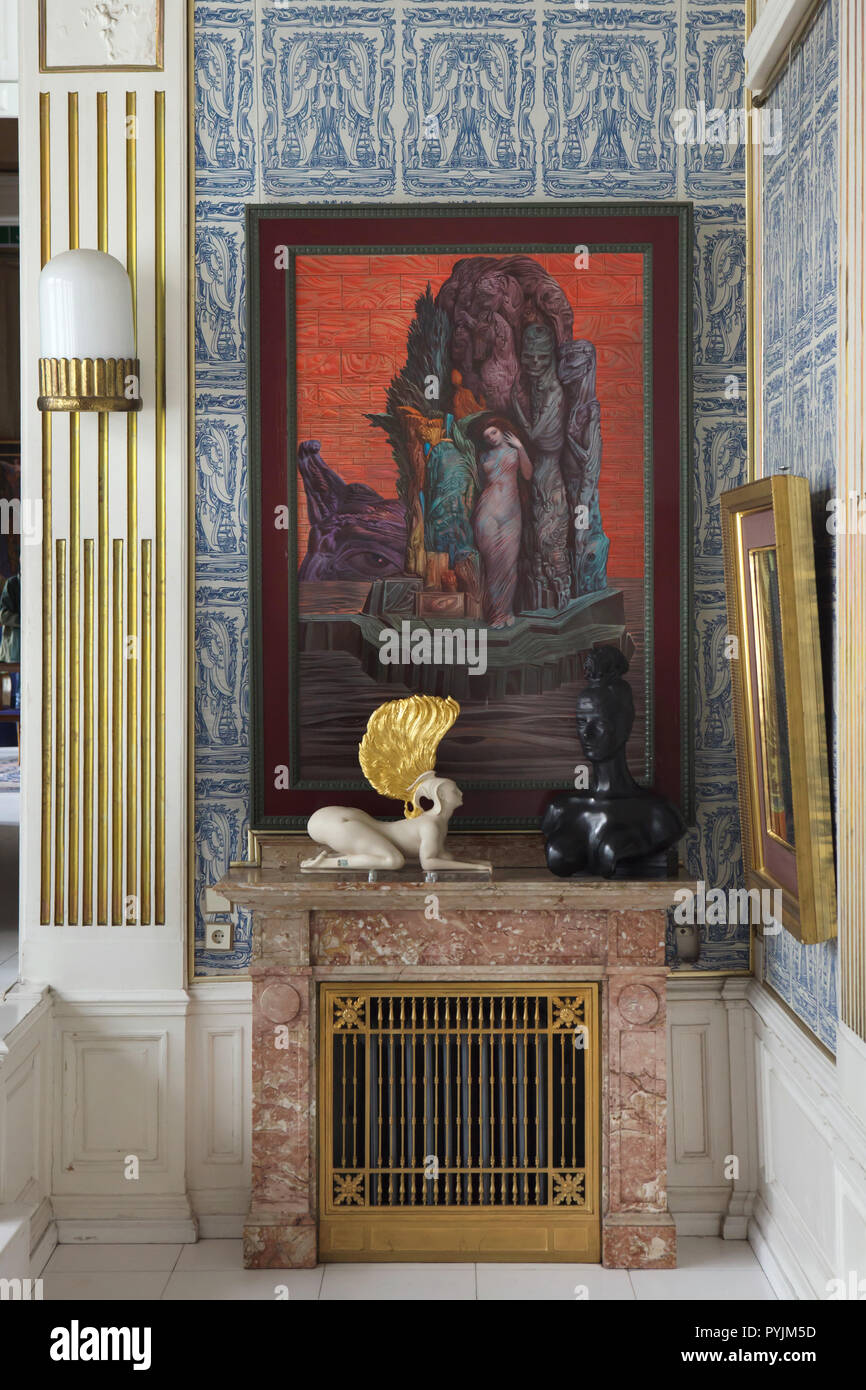 Paintings and sculptures by Austrian artist Ernst Fuchs on display in the Blue Parlor in the Ernst Fuchs Museum in Vienna, Austria. The museum is housed in the former Wagner Villa I designed by Austrian modernist architect Otto Wagner and built in 1886-1888 in Hütteldorf district. The building was acquired and rebuilt by Ernst Fuchs in the 1970s. - Stock Image