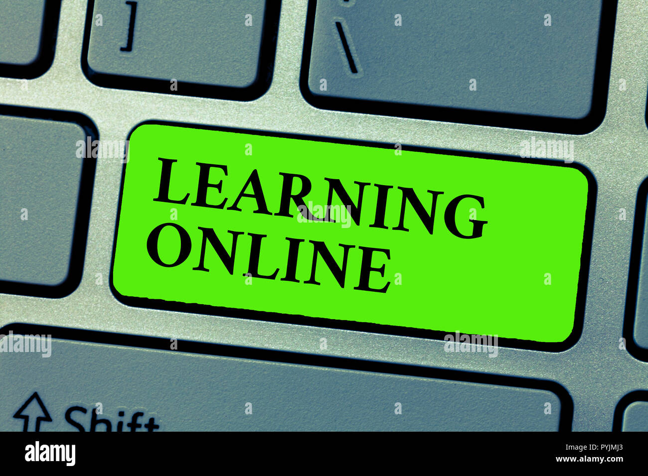 Conceptual hand writing showing Learning Online. Business photo text Learn something new with the help of internet and technology. - Stock Image
