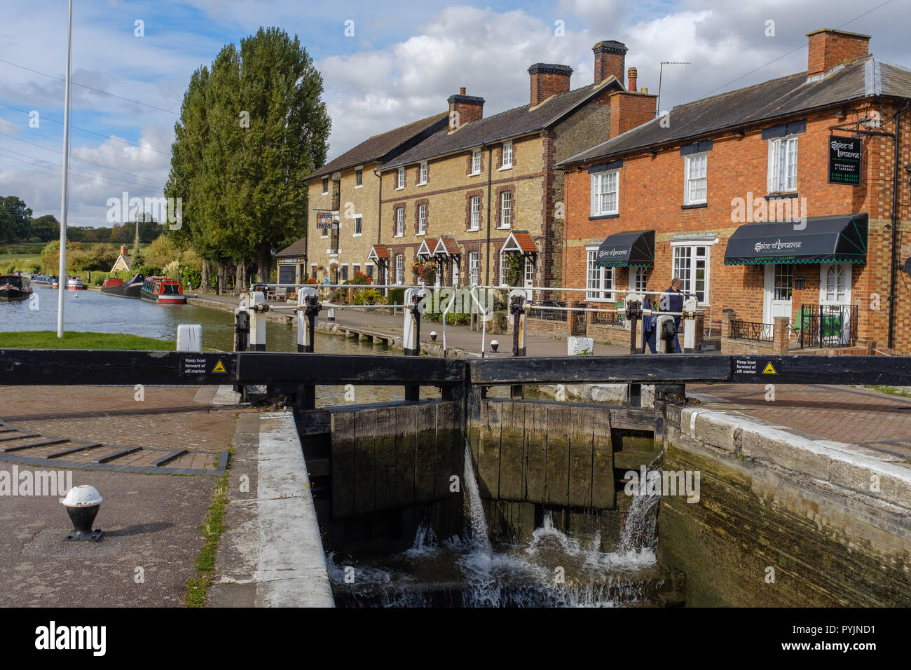 View across canal lock to The Canal Museum at Stoke Bruerne on the Grand Union Canal, Northampton, England - Stock Image
