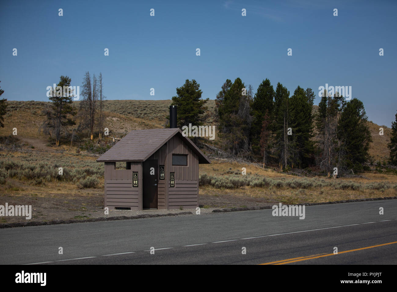 National park roadside facilities with parking area and blue skies. - Stock Image