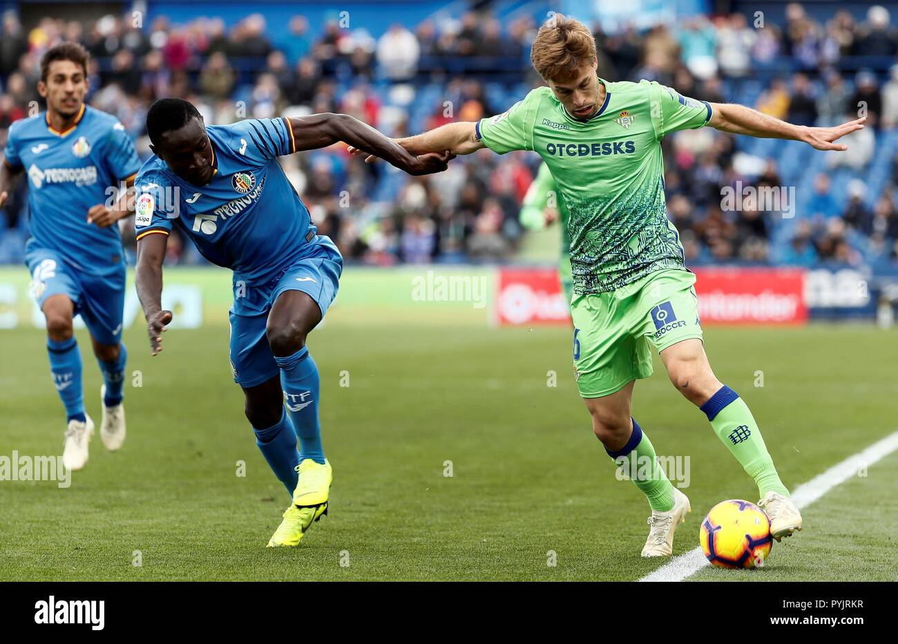 c00e38f03 Getafe CF s Senegalese striker Amath Ndiaye (L) fights for the ball with  Real Betis