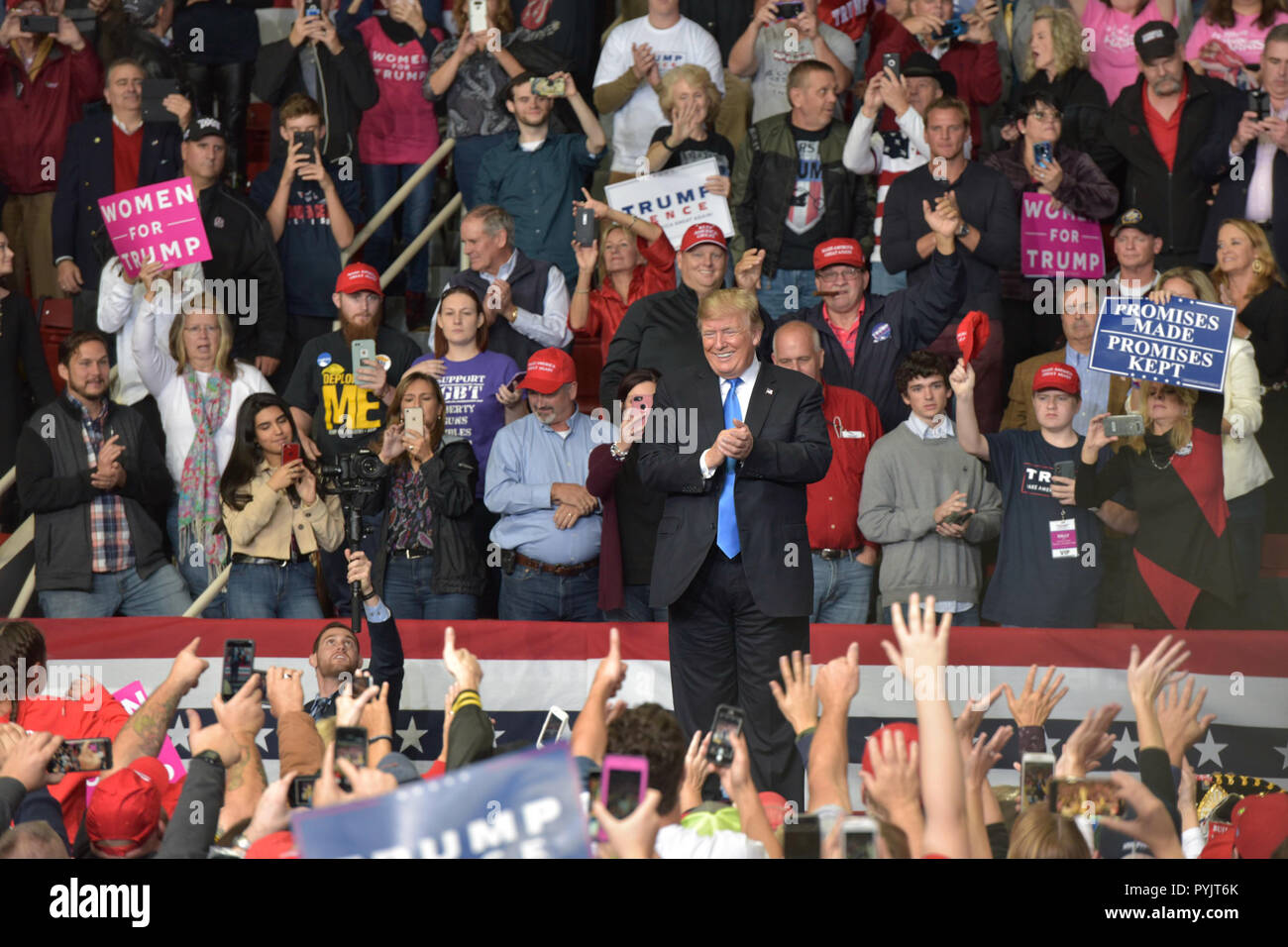 Charlotte, NC, USA, USA.  26 Oct 2018. US President Trump attends a MAGA Rally to campaign for 9th District House Candidate, Mark Harris. Trump's supporters braved cold weather and hard rain, some arriving over a day early, to hear the president speak.  Photo Credit: Castle Light Images / Alamy Live News Stock Photo