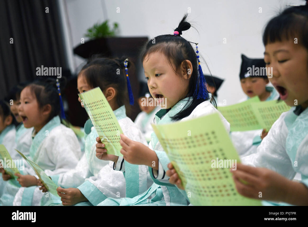 Yingtan, China's Jiangxi Province. 28th Oct, 2018. Students read classics of Chinese literature at a community center in Yingtan City, east China's Jiangxi Province, Oct. 28, 2018. The community offers classes on traditional Chinese culture once a week for children as extracurricular activities. Credit: Wan Xiang/Xinhua/Alamy Live News - Stock Image