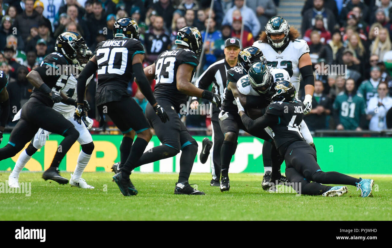 London, UK.  28 October 2018. Eagles running back Wendell Smallwood  (28) is tackled. Philadelphia Eagles at Jacksonville Jaguars NFL game at Wembley Stadium, the final game in the NFL London 2018 series.  Credit: Stephen Chung / Alamy Live News - Stock Image