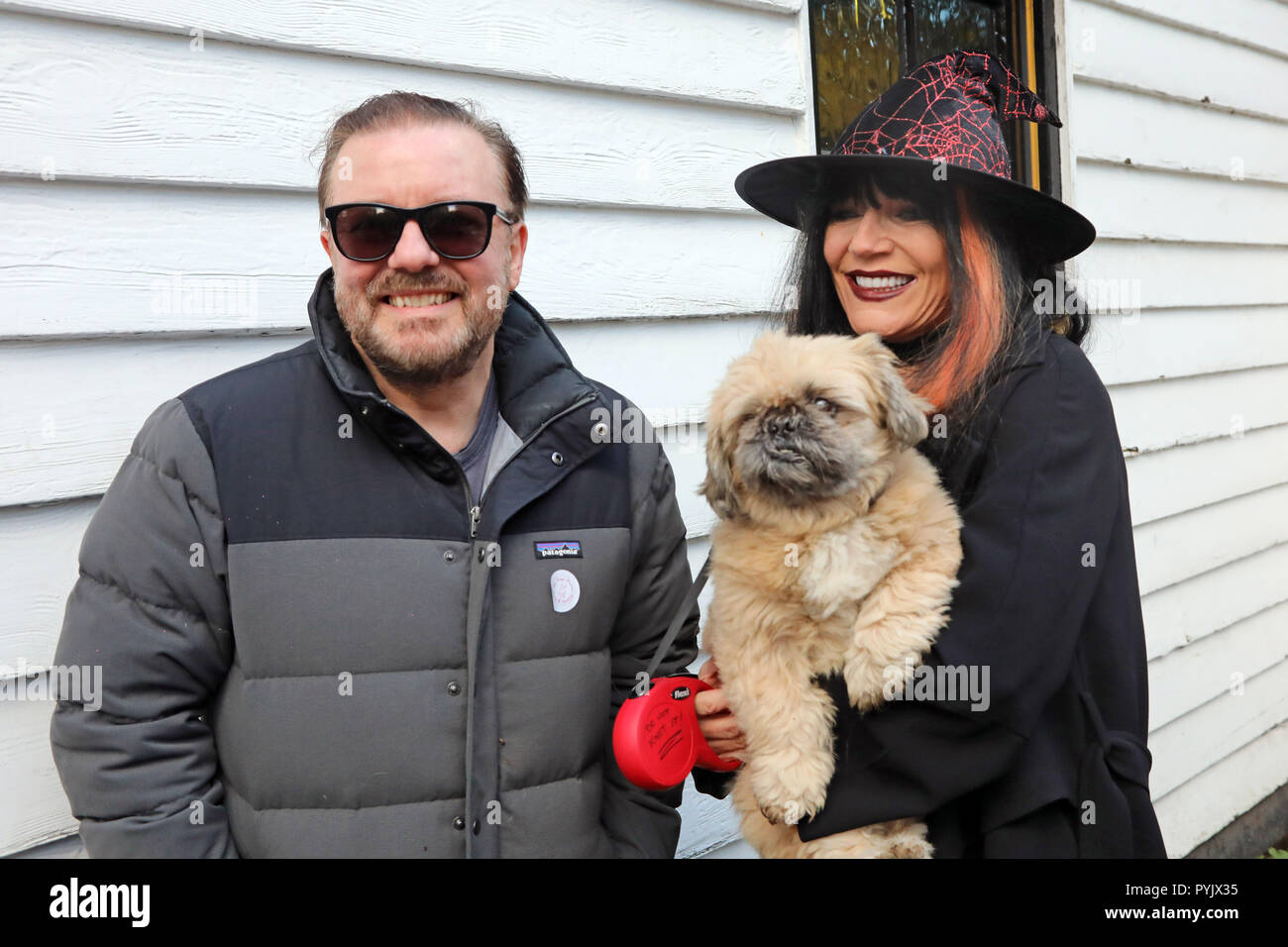 London, UK. 28th October 2018. Charity supporters Ricky Gervais and Michelle Collins with her dog Humphrey at the All Dogs Matter Halloween Dog Walk, Hampstead Heath, London, UK. The annual walk takes place to raise funds for the charity which rehouses and finds homes for dogs. Credit: Paul Brown/Alamy Live News - Stock Image