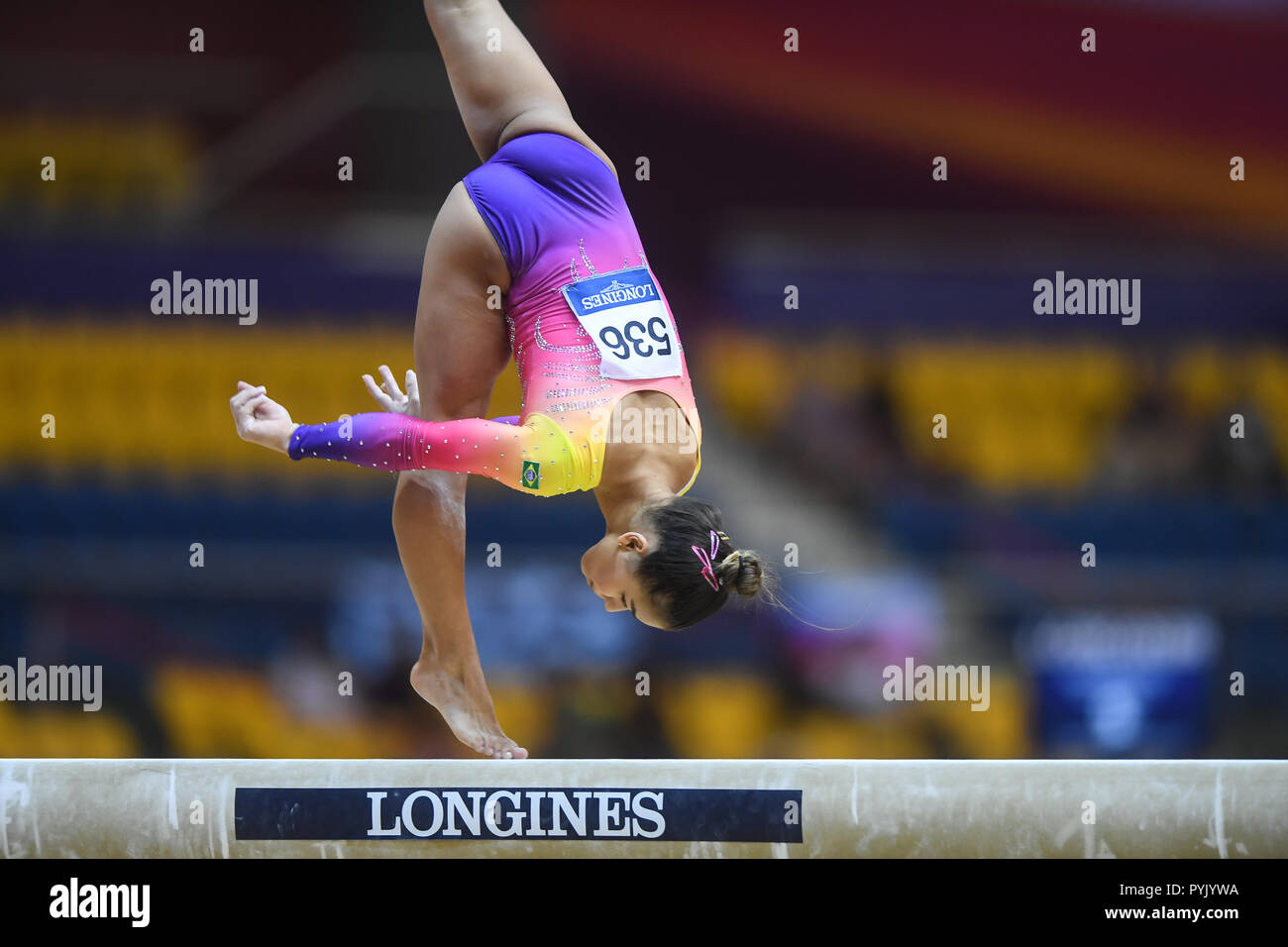 Doha, Qatar. 28th Oct, 2018. FLAVIA SARAIVA competes on the balance beam during the second day of preliminary competition held at the Aspire Dome in Doha, Qatar. Credit: Amy Sanderson/ZUMA Wire/Alamy Live News - Stock Image