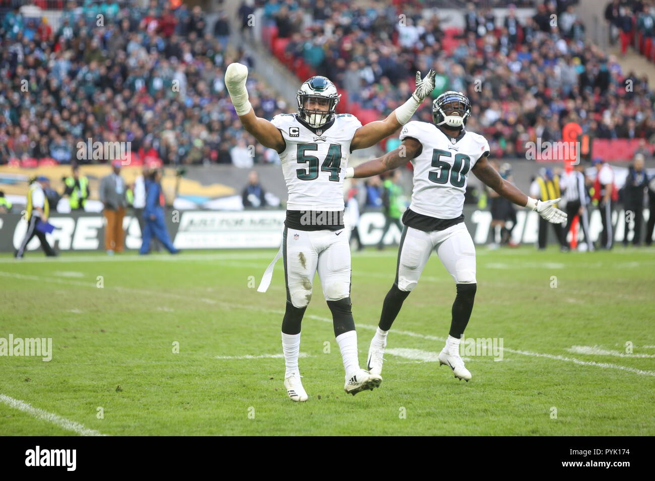 London, UK. 28 October 2018.   Philadelphia Eagles Linebacker Kamu Grugier-Hill (54) and Philadelphia Eagles Linebacker Paul Worrilow (50) celebration  at the Eagles at Jaguars - credit Glamourstock Credit: glamourstock/Alamy Live News - Stock Image