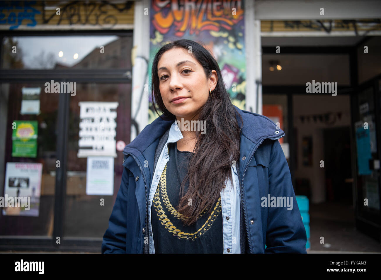 """Berlin, Germany. 26th Oct, 2018. 26 October 2018, Germany, Berlin: Sinaya Sanchis, employee of the Neukoelln girls' club """"Schilleria"""", stands in front of the entrance of the Neukoelln club. Due to the tense real estate market in Berlin, social housing projects are also increasingly being squeezed out. (to """"Association fears displacement of social housing projects"""" of 29.10.2018) Credit: Arne Immanuel Bänsch/dpa/Alamy Live News Stock Photo"""