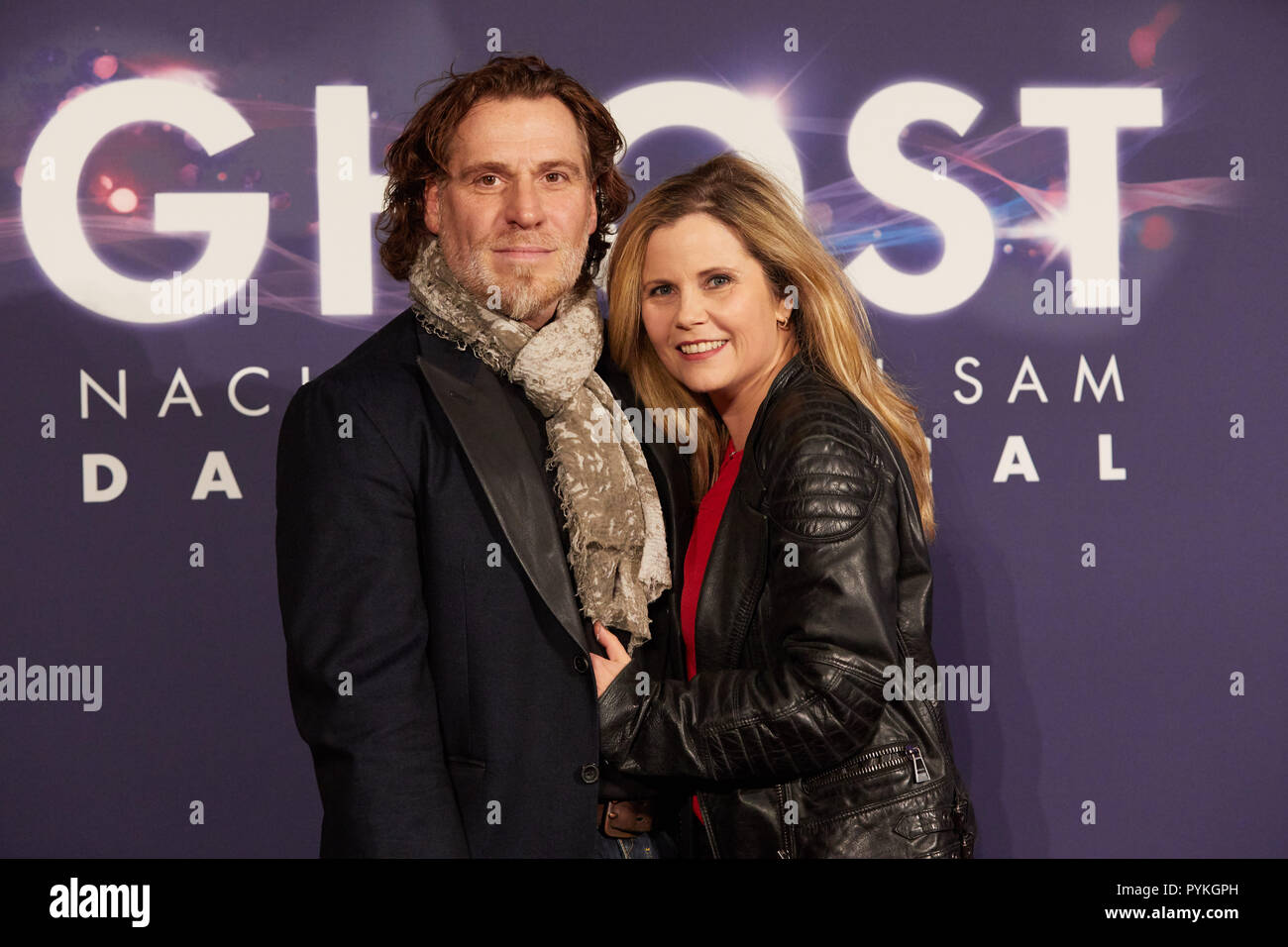 "Hamburg, Germany. 28th Oct, 2018. Michaela Schaffrath, actress, and her husband Carlos Anthonyo come to the Hamburg premiere of the musical ""Ghost"". The musical will be a guest at the Operettenhaus until the end of February. Credit: Georg Wendt/dpa/Alamy Live News Stock Photo"
