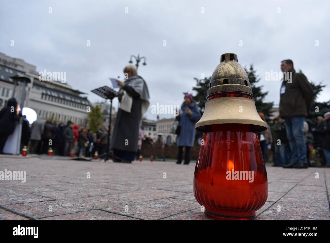 29 October 2018, Russia, Moscow: Hundreds of people remembered the victims of the terror under Soviet dictator Josef Stalin at a vigil. They set up straight candles and laid flowers in front of the building where the Soviet secret service KGB used to be based and where the domestic secret service FSB now resides. They also read out the names of the victims. Photo: Christian Thiele/dpa-Zentralbild/dpa - Stock Image