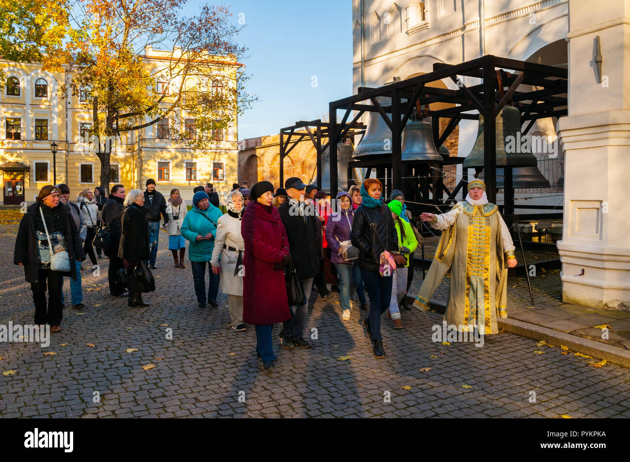 Veliky Novgorod, Russia - October 17, 2018. Tour guide actress and tourists at the excursion at the territory of Novgorod Kremlin park, Veliky Novgoro - Stock Image