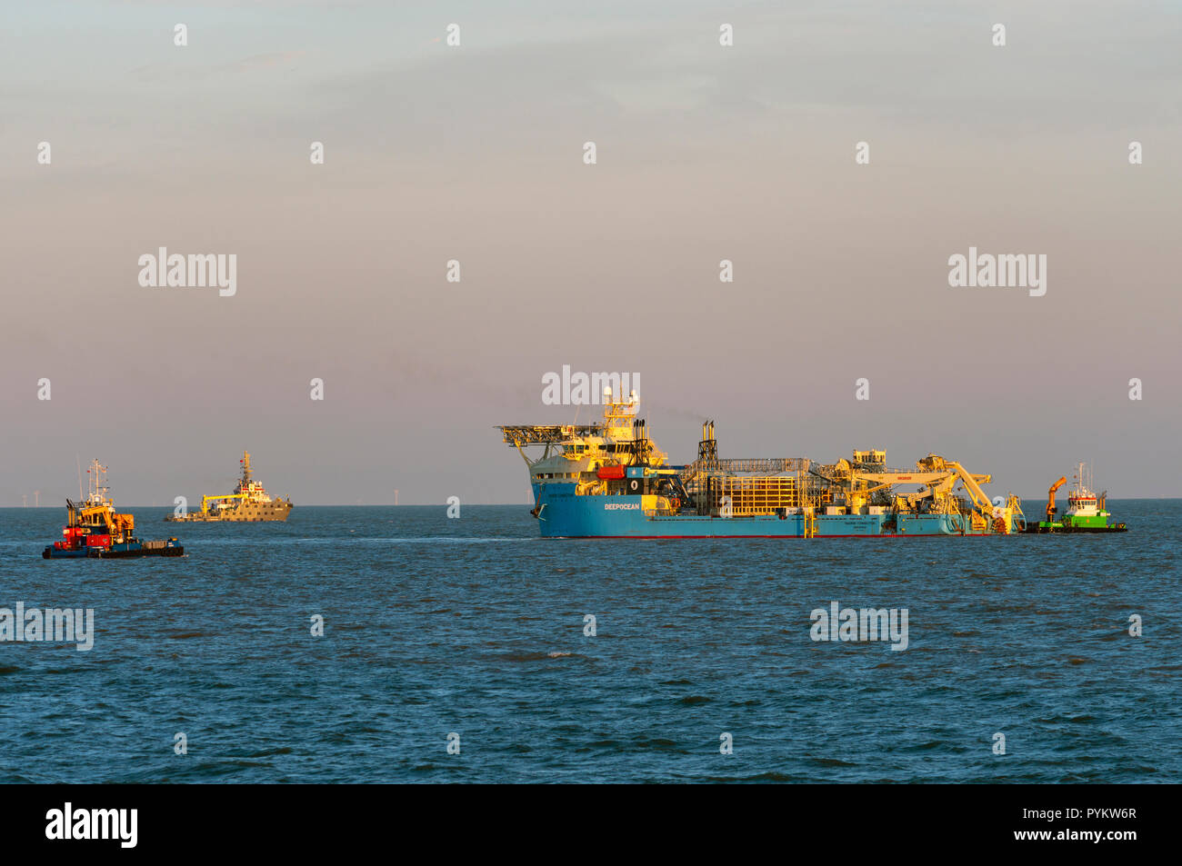 Ship laying electric cables to East Anglia One offshore wind farm, East Lane, Bawdsey, Suffolk, UK. - Stock Image