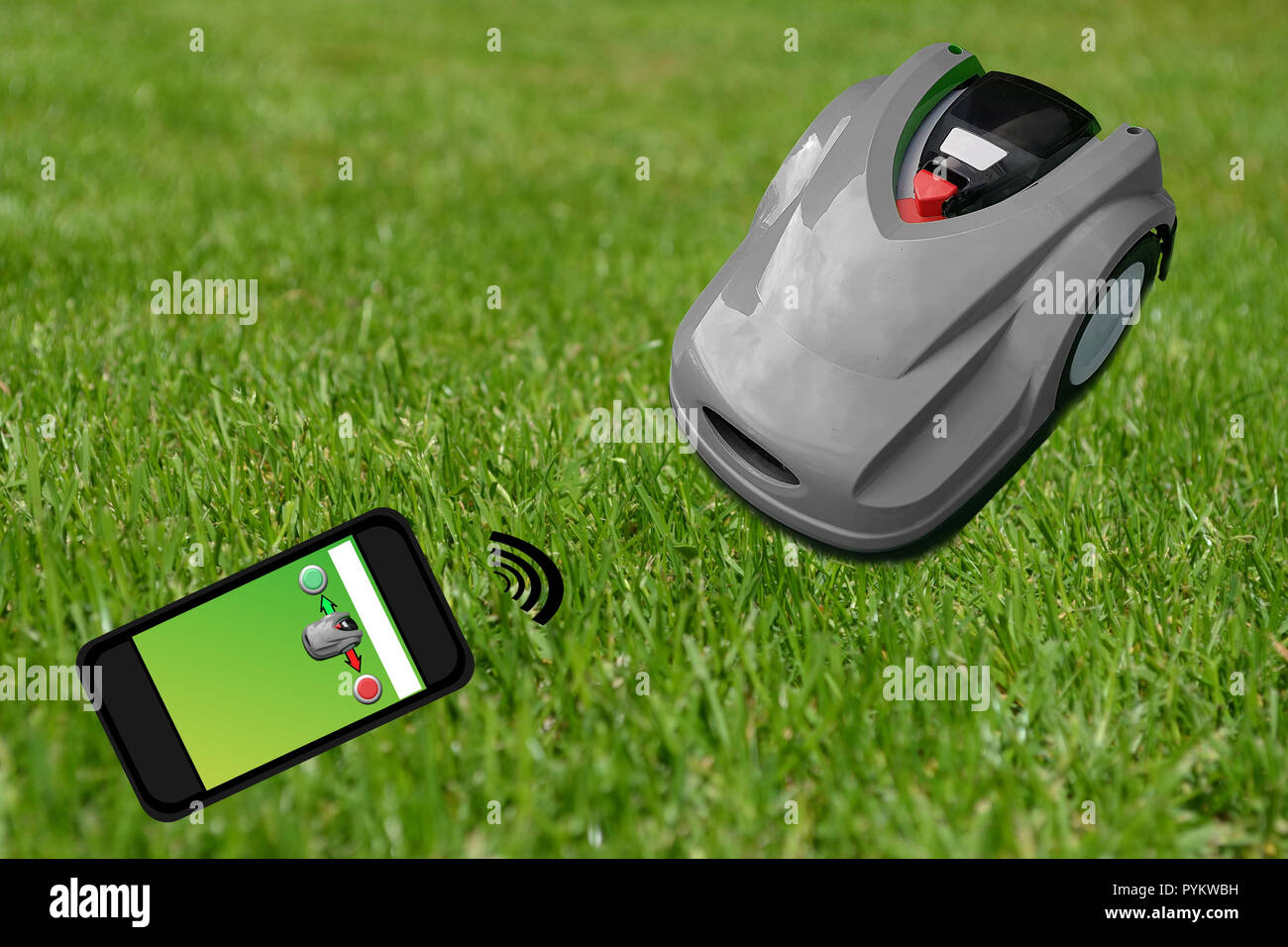 Robot lawn mower on a manicured green lawn. Control with the smartphone Stock Photo