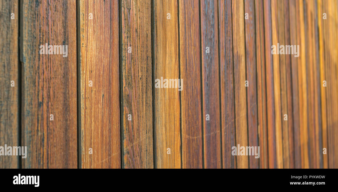 Wooden wall made of brown horizontal planks - Stock Image