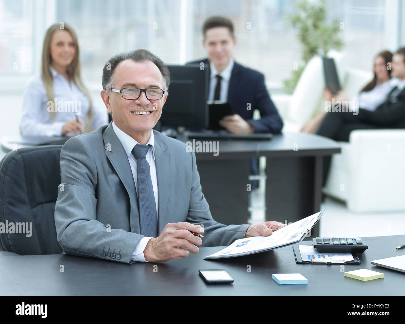 experienced businessman working with financial documents office - Stock Image