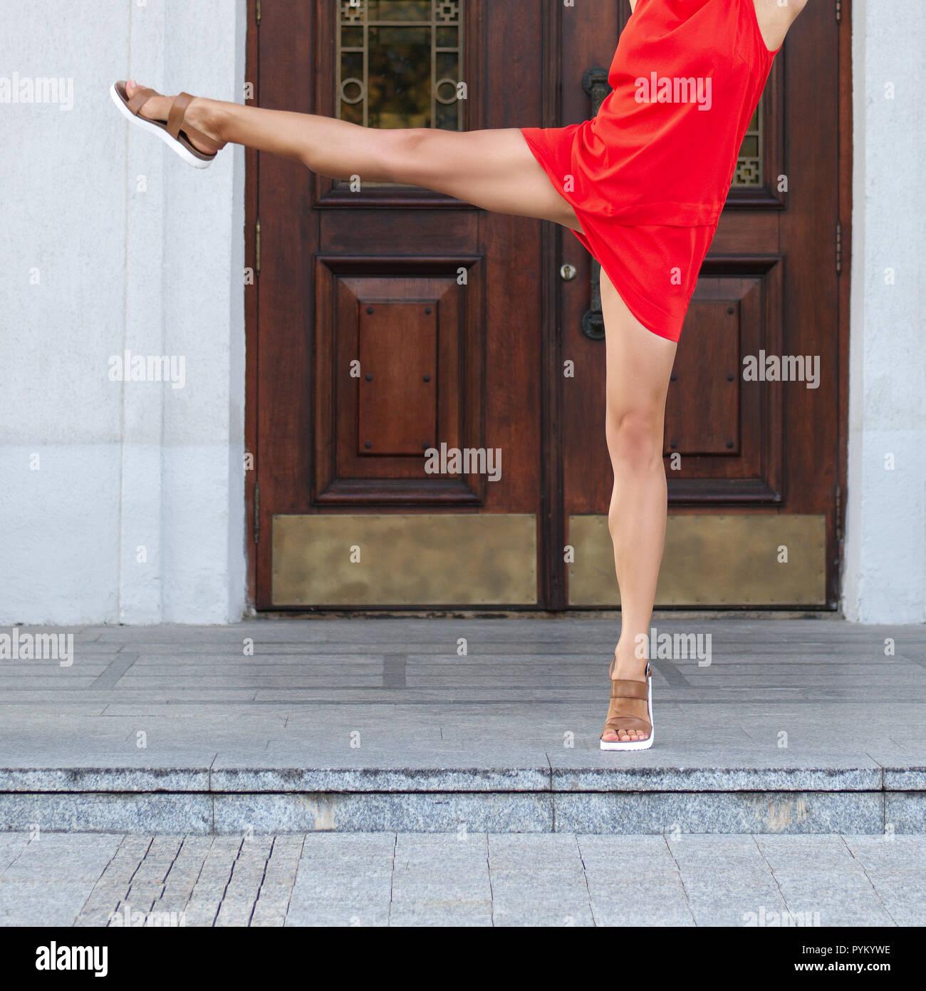 Close up slim woman legs. Street gymnastics. - Stock Image