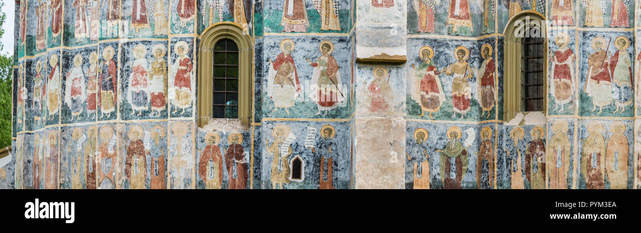 ROMANIA, SUCEVITA. Like a big picture book the frescos on the walls of the painted churches of Moldavia show episodes of the Old and New Testament - Stock Image