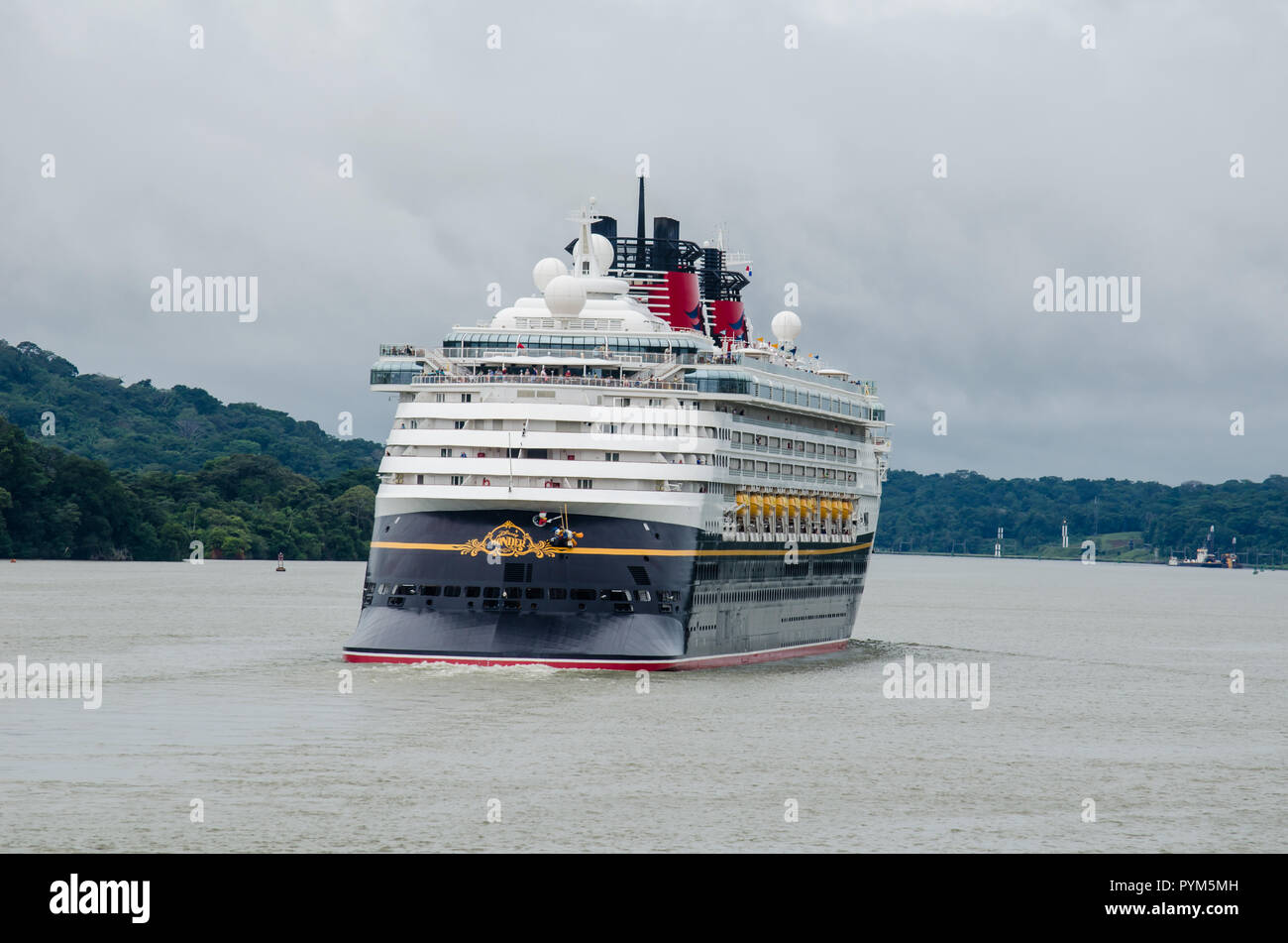 Panama Canal cruise season 2018 - 2019 is ongoing.  The picture shows the Disney Wonder transiting the waterway at the end of Gaillard Cut in Gamboa Stock Photo