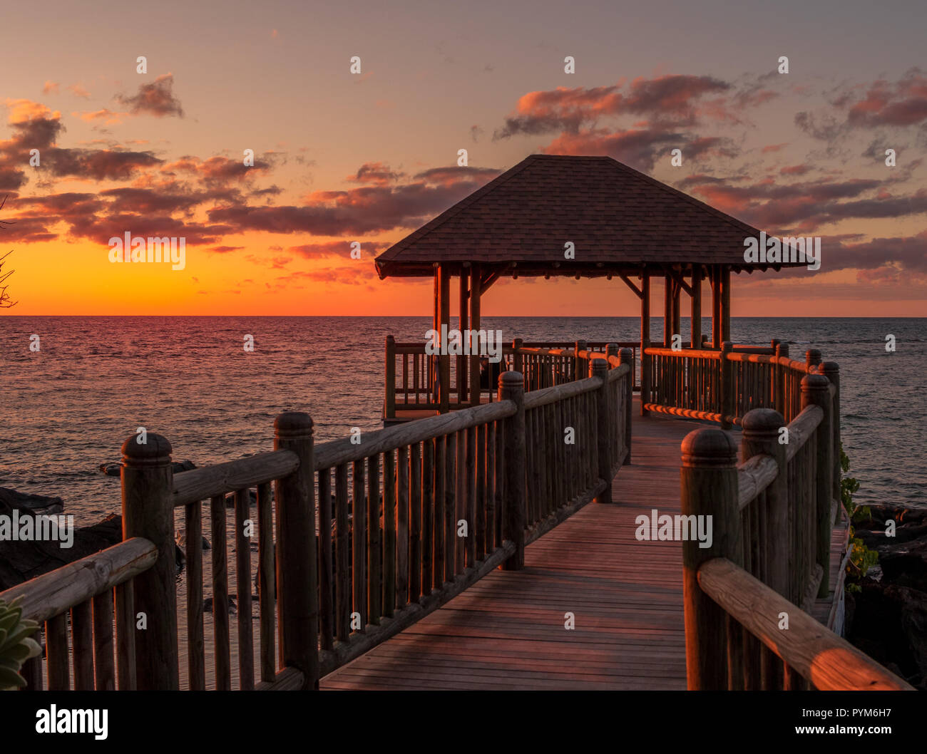 Balaclava, Mauritius - Sunset over the wooden deck at the Westin Turtle Bay Resort and Spa on the island image with copy space - Stock Image