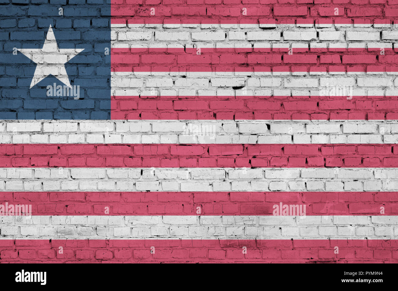 Liberia flag is painted onto an old brick wall - Stock Image