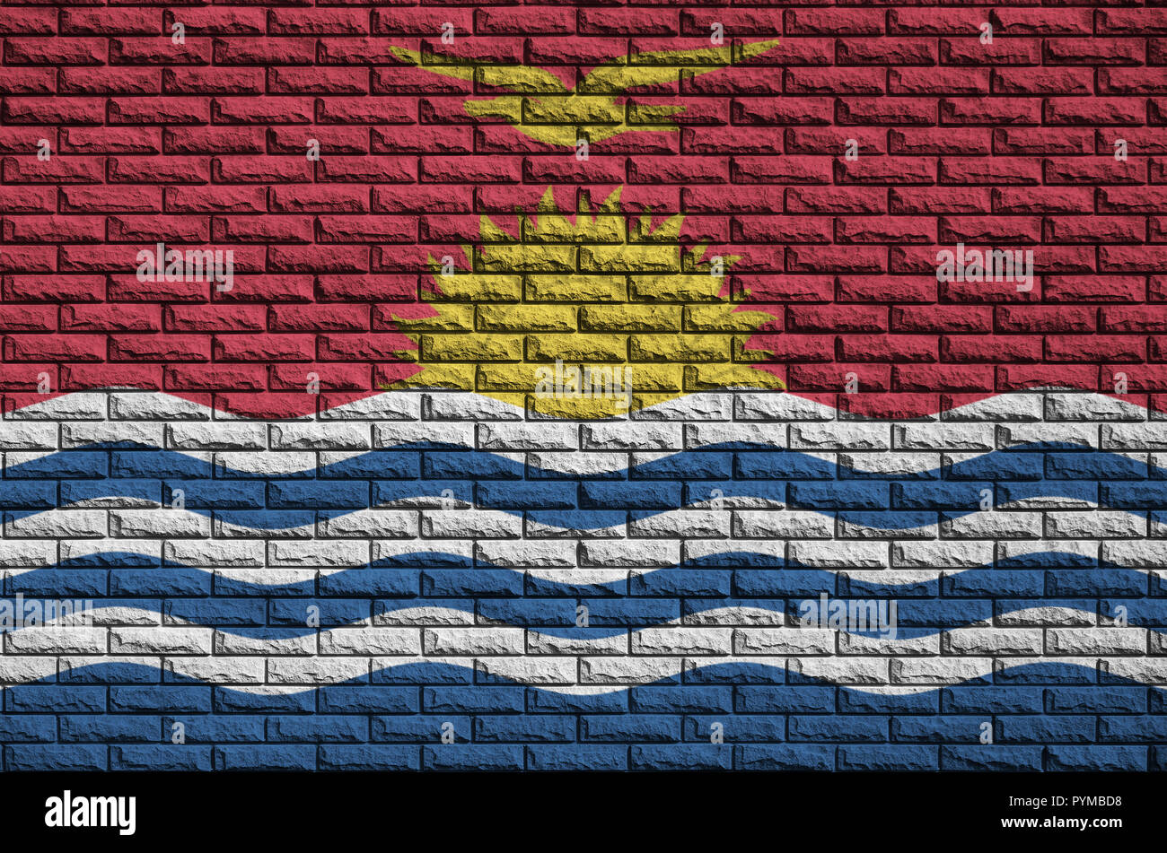 Kiribati flag is painted onto an old brick wall - Stock Image