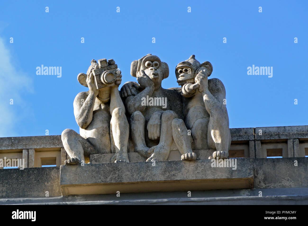 Three Wise Monkeys sculpture on the roof of Waterloo Park Pavilion, Norwich, Norfolk, UK Stock Photo