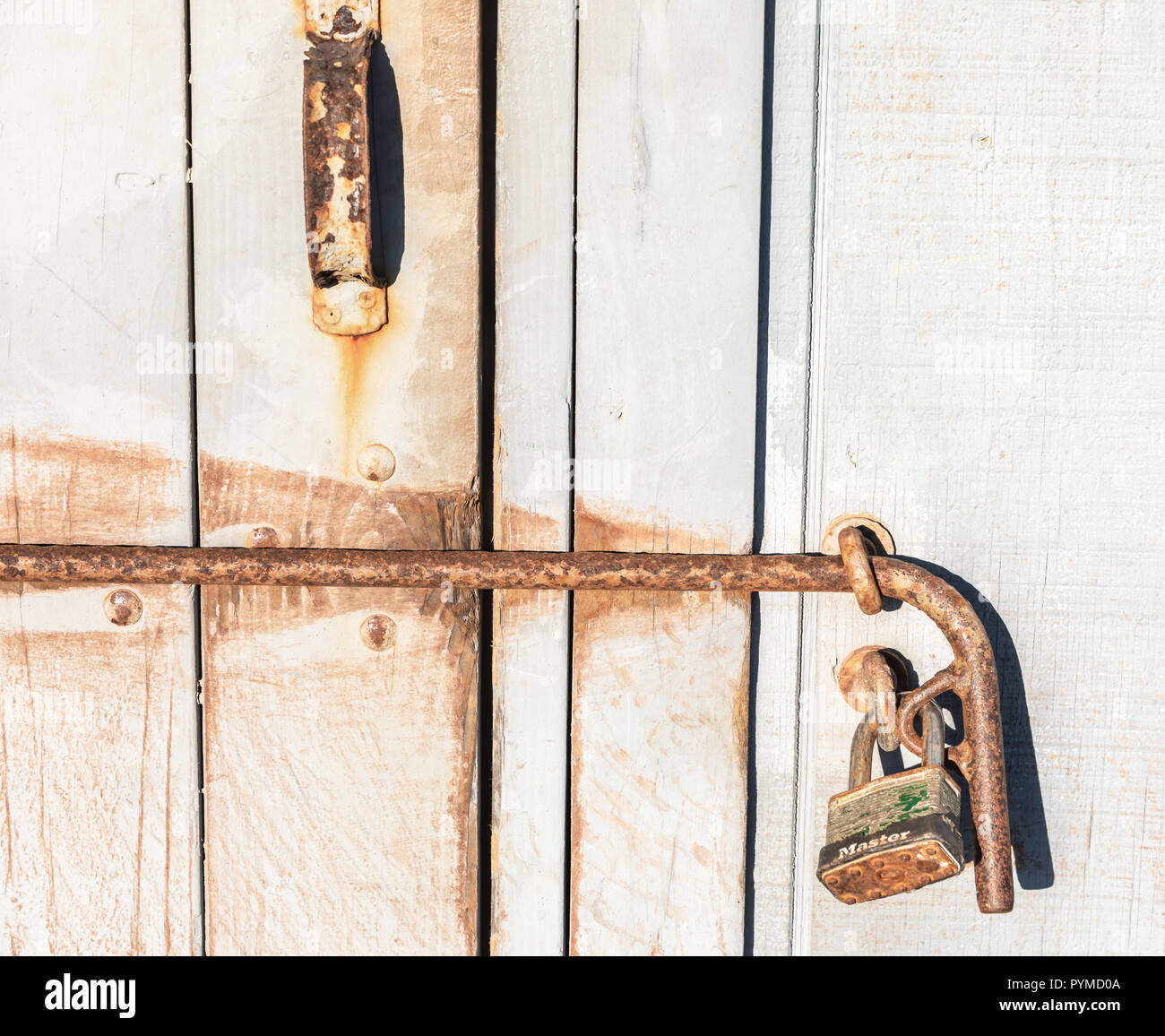 Detail image of a pad lock on a old shed at the beach in Bridgehampton, NYh, - Stock Image