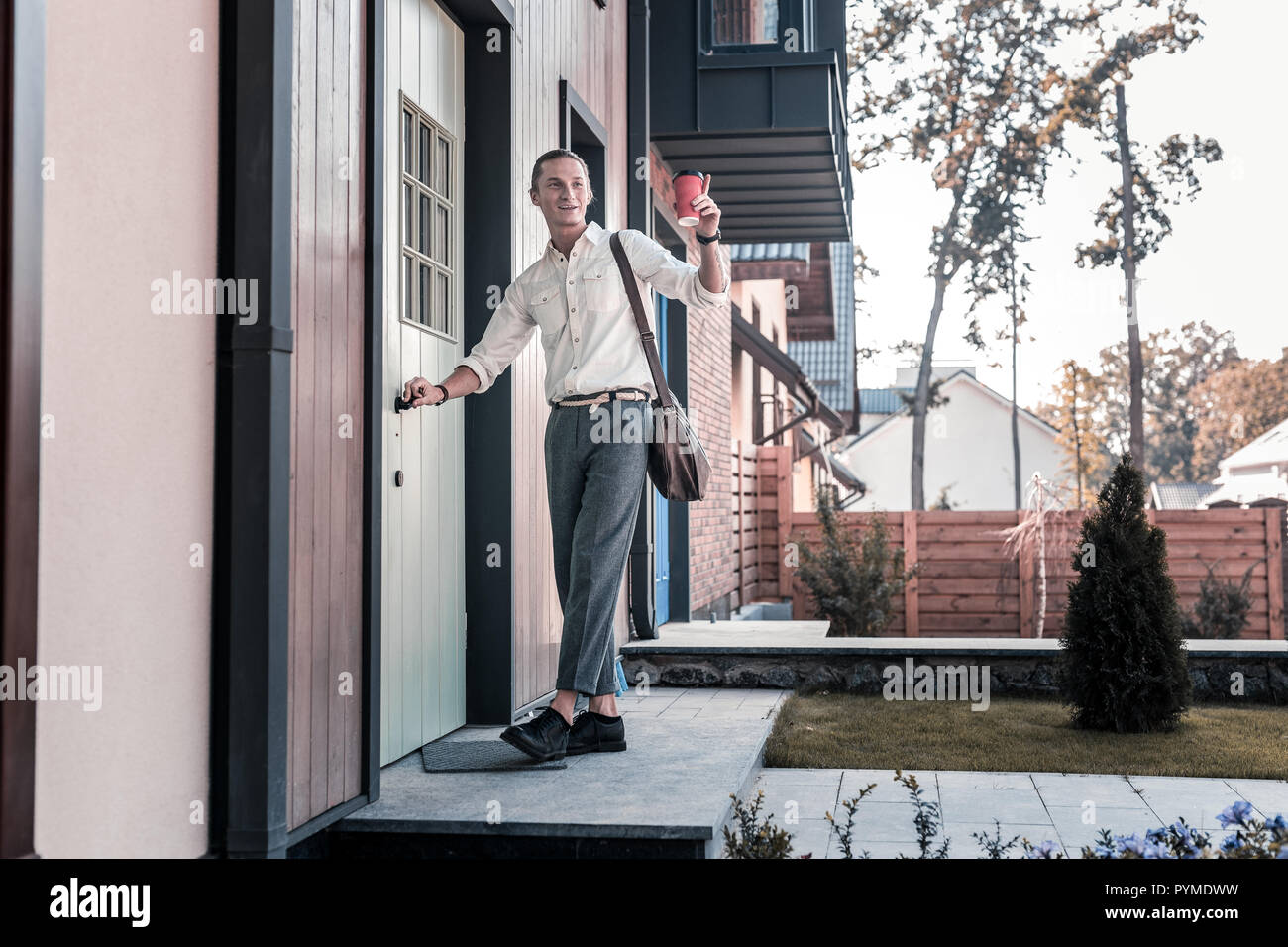 Blonde Haired Man With Takeaway Coffee Talking To His Neighbor In The Morning