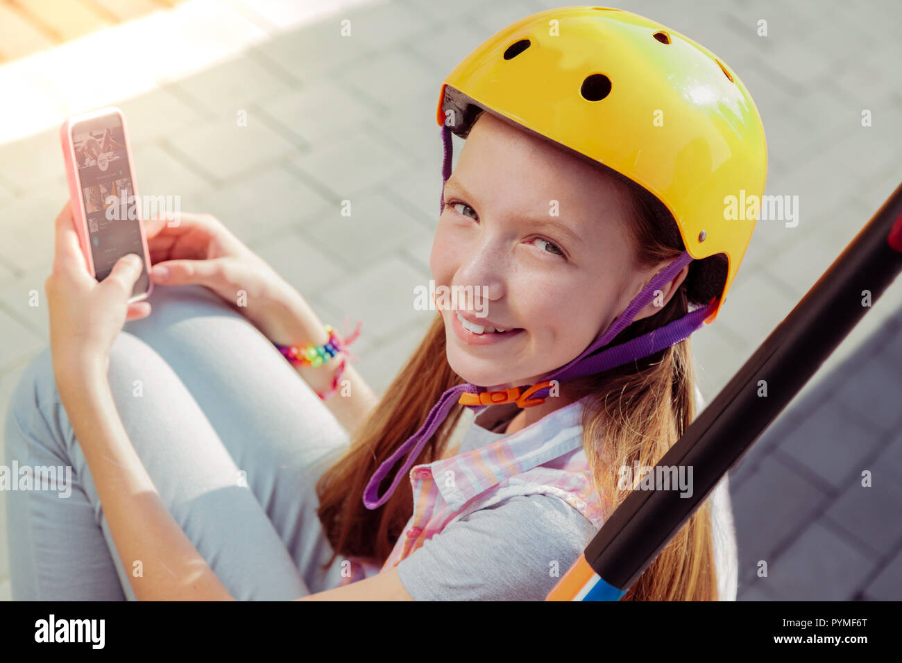 Positive delighted teenager having break on air - Stock Image
