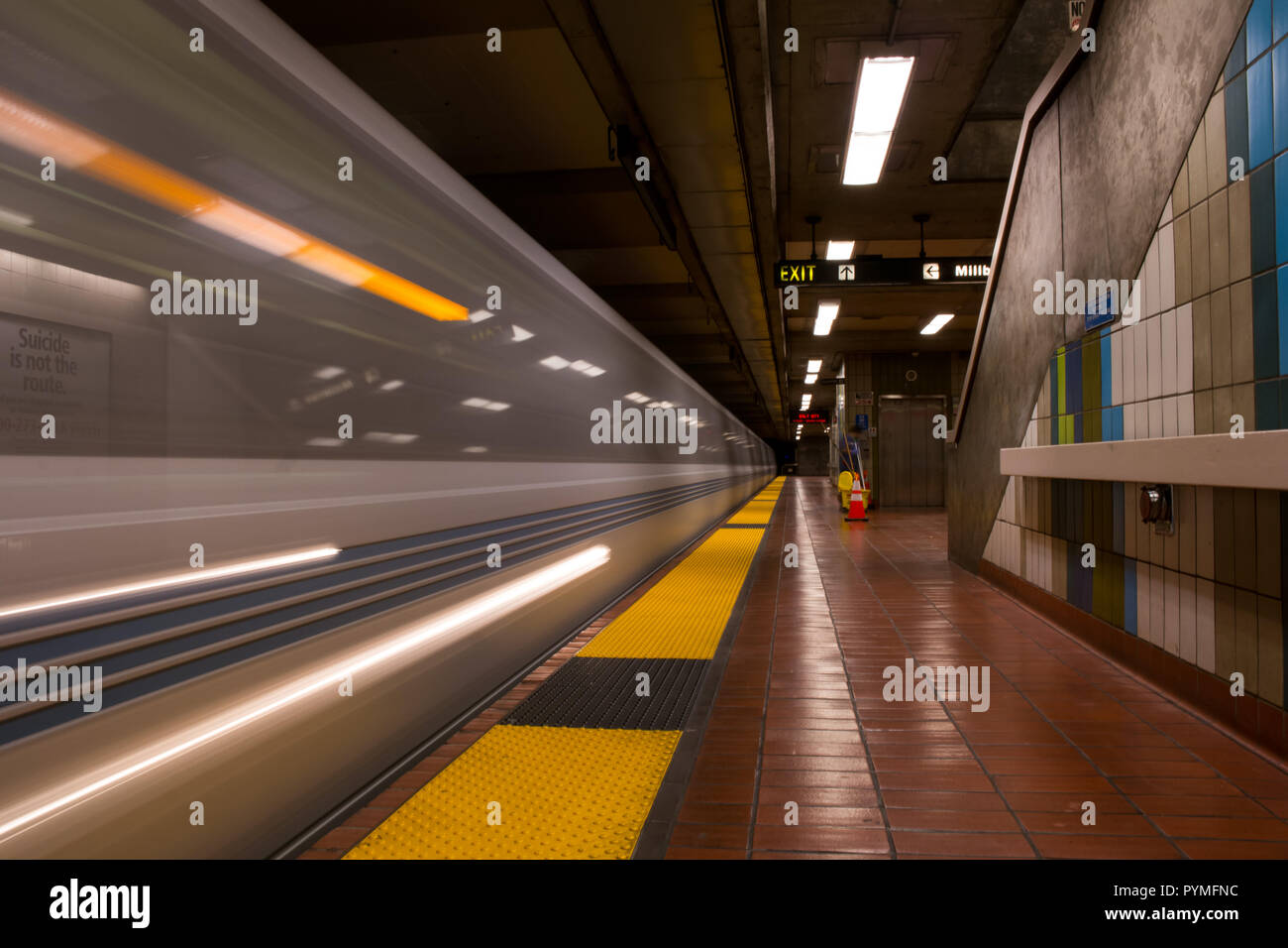 Subway train passing by with high speed motion blur long exposure in the San Francisco Bay Area - Stock Image