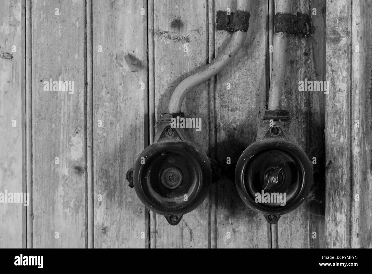 Antique electric power switches in an old Swedish farm in northern Sweden - Stock Image